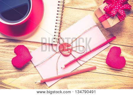 Blank notepad coffee cup and love hearts on wooden table