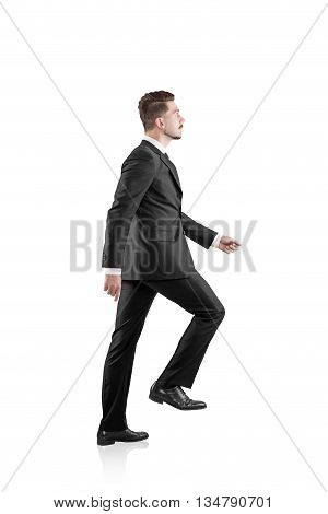 Side view of walking businessman in suit isolated on white background