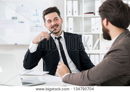 Attractive Businessmen Discussing Something