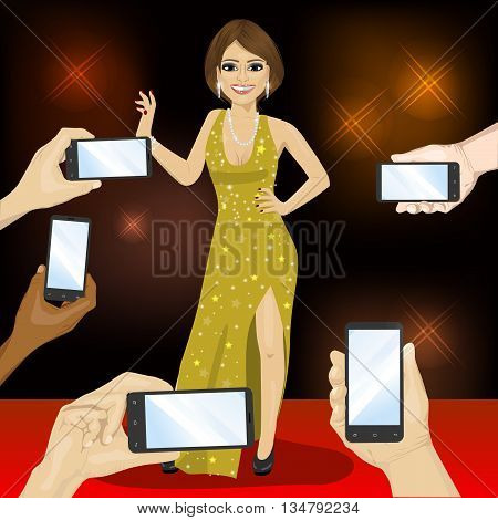 Young famous woman posing on a red carpet for people with smartphones