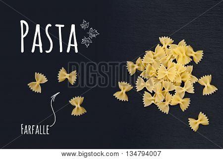 Uncooked Italian Pasta Farfalle On Black Slate Stone Background