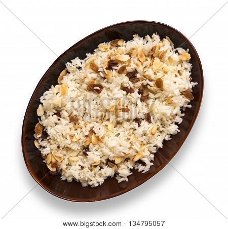Rice dish with roasted almonds and dried raisins isolated on white