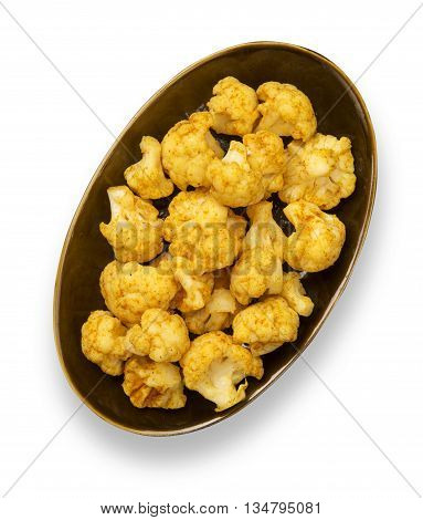 Roasted spicy cauliflower florets isolated on white