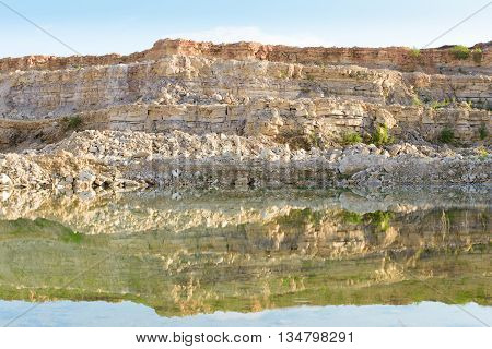 Lake in limestone quarry in the development of rock