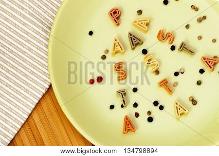 Bowl of pasta shaped small letters. Close-up. Backgraund