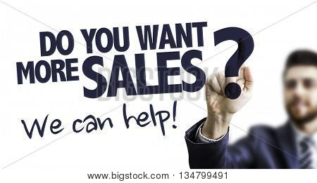 Business Man Pointing the Text: Do You Want More Sales? We Can Help!
