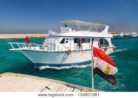 HURGHADA, EGYPT - FEBRUARY 12, 2016: Boat approaching dock at at Paradise Island.