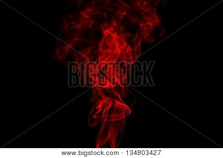 Red smoke abstract in black background isolated