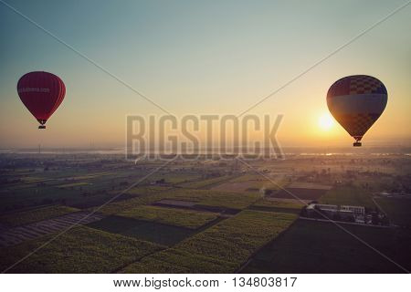 Hot air ballooning  over the Valley of the Kings and Nile river.