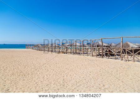 Beach huts at sandy beach.