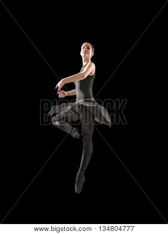 Young woman makes exercise isolated on gray background