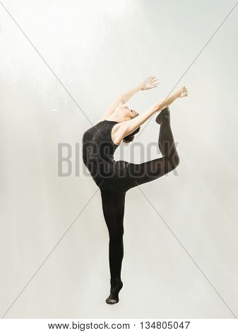 Young woman makes exercise isolated on white background
