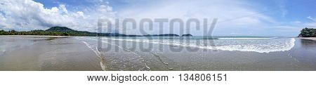 Beach Playa Samara in Costa Rica on the Pacific coast. Panorama of several frames