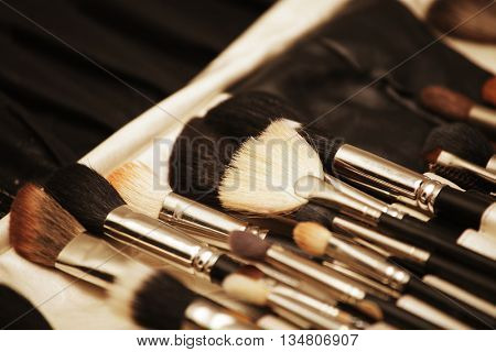 Closeup of makeup tools in their holder