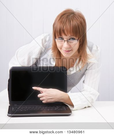 Girl Shows A Finger On A Laptop