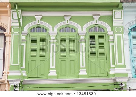 Colorful windows Sino-Portuguese style architecture at Phuket Thailand. Classic vintage windows