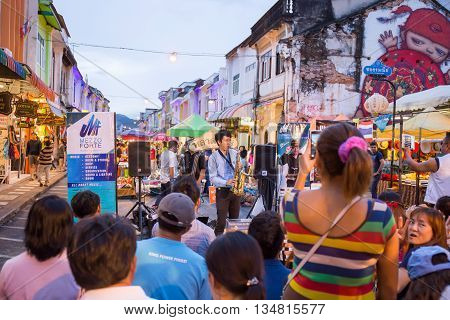 PHUKET THAILAND MAY 29 2016: Musician play saxophone jazz at night market of Phuket on May 29 2016.among old building Chino Portuguese style street of Phuket town is the famous popular