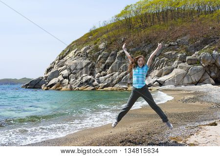 Girl Is Standing On The Sea Stone