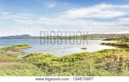 Landsacape Nature View Background Of Reservoir With Green Forest And Mountain In Wide Puffy Clouds F