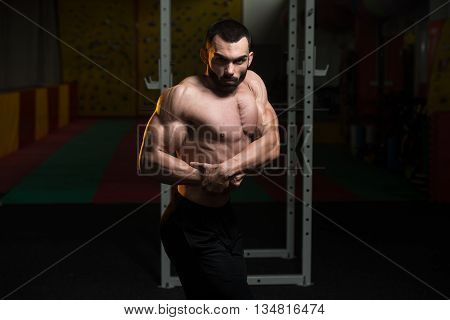Young Bodybuilder Flexing Muscles Side Chest Pose