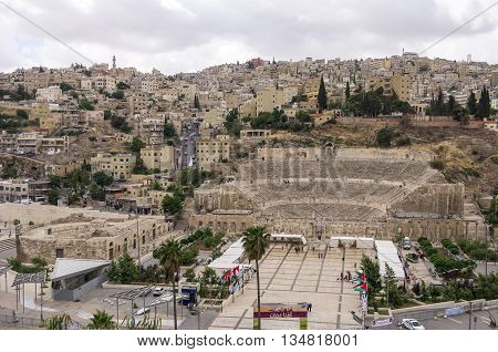 Amman, Jordan -May 28, 2016: Cityscape of Amman downtown with Roman amphitheatre from citadel Amman Jordan