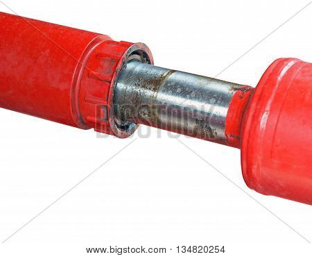A Chrome Hydraulic Cylinder on a Piece of Machinery