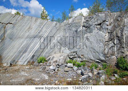 Figure karelian marble on a cliff in the Italian career. Ruskeala, Karelia