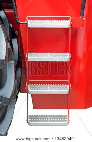 metal steps in the tractor cab on white background