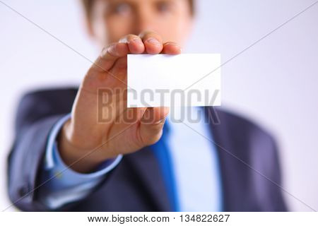 young businessman holds out his hand with a business card for love.