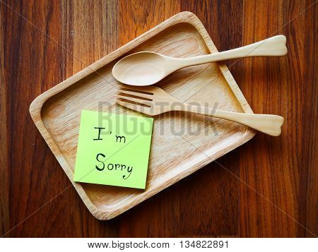 I'm sorry note with wooden plate in morning on top view