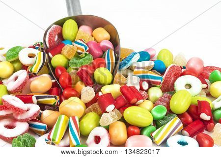 Different colored candies isolated in white background.