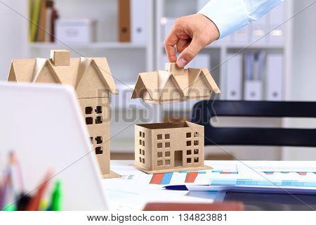 Designer shows a model of a new home.