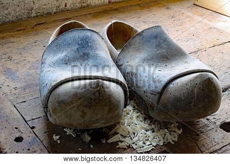 Dutch Style Wooden Clogs In The Workshop Of A Shoemaker