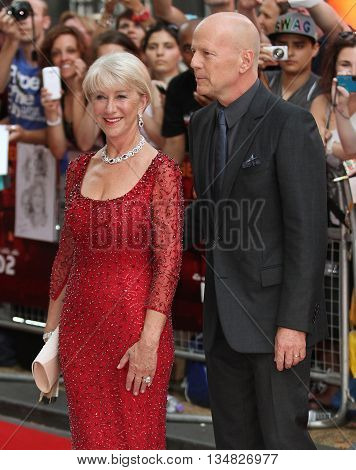 LONDON, UK, JUL 22, 2013: Dame Helen Mirren and Bruce Willis attend the European Premiere of Red 2 picture taken from the street