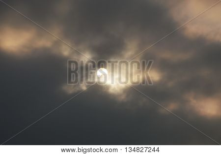partial eclipse on sky in cloudy day