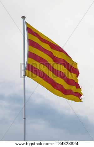 catalan flag in detail with sky background