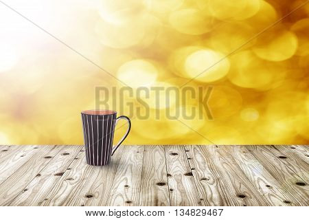 Cup of coffee on wooden table on blur boheh