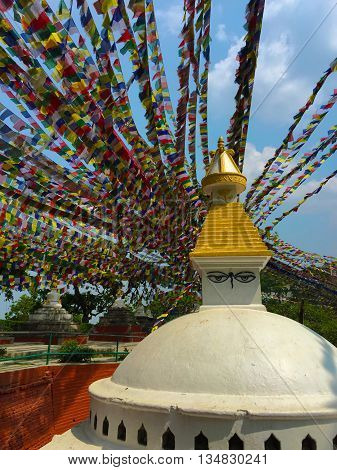 uddhist stupa and colorful prayer flags, white buddhist temple and flag ribbons