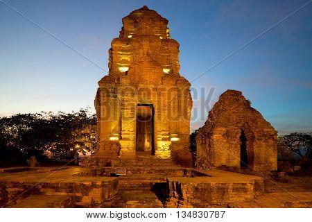 Ancient sanctuaries (Cham towers) in the evening twilight. Phan Thiet, Vietnam