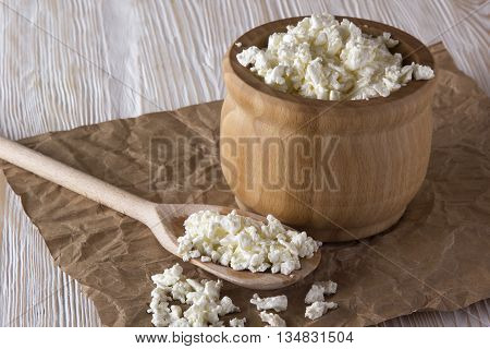 Cottage cheese on the white wooden background