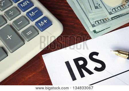 IRS written on a paper. Financial concept.