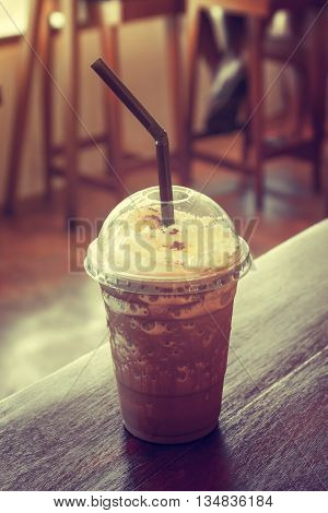 Iced coffee on table in coffee shop in vintage style