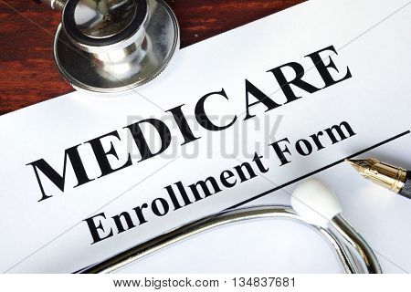 Medicare enrollment form written on a paper.  Medical concept.