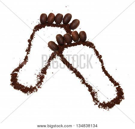 foot lined with grains of ground and instant coffee isolated on white background scrapbook footprints