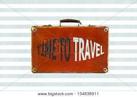 Old shabby brown suitcase on watercolor blue stripes background. Time to travel sign. Time to Travel concept with retro suitcase. Travel Concept on the stylish background with vintage travel bag.