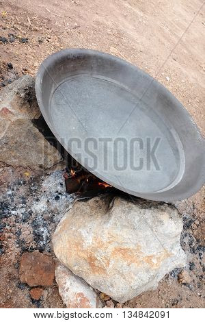 Old pan and craft for steam cooking on stove in Thailand