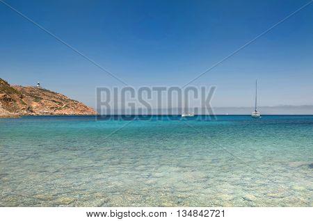 beautiful sea with sailing at horizon in Corsica Revellata