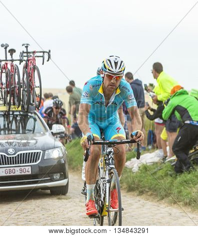 Quievy, France - July 07 2015: The Dutch cyclist Lieuwe Westra of Astana Team riding on a cobblestone road during the stage 4 of Le Tour de France 2015 in Quievy France on 07 July 2015.