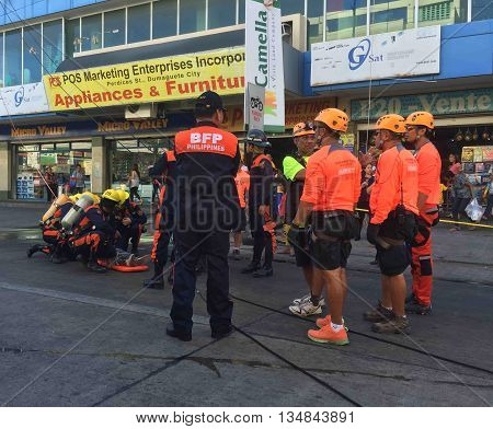Dumaguete, Philippines - 30 March, 2016: Rescue operation during a fire. Rescue help to the victim of a fire