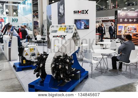 RUSSIA MOSCOW - May 31 2016: Visitors at the International Specialized Exhibition of Construction Equipment and Technologies at Crocus Expo. Construction Equipment Exhibition in Moscow
